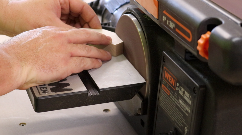 Smoothing the cuts with the disc sander