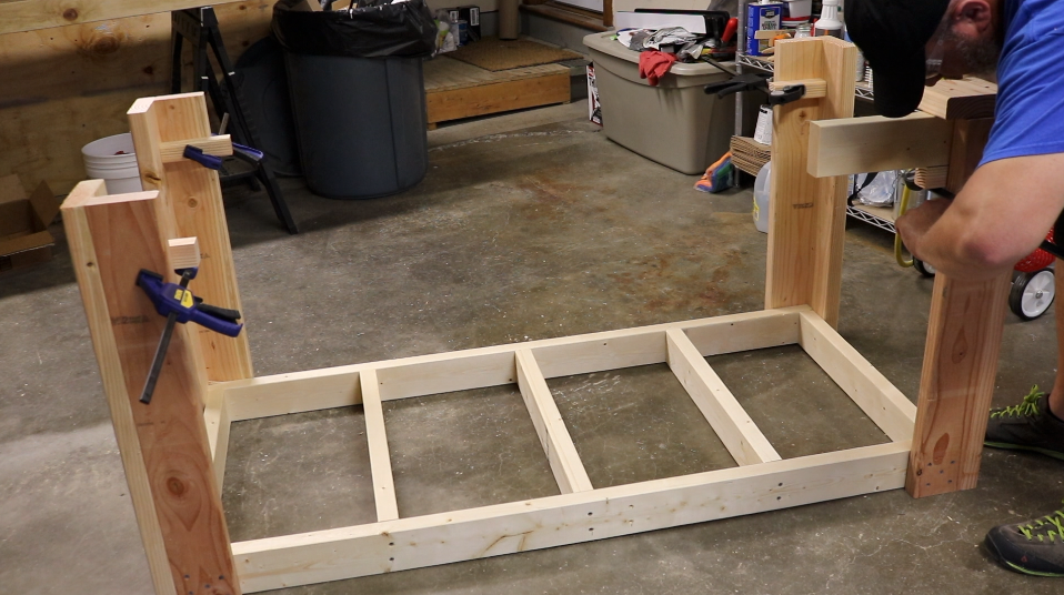 Use some scraps and clamps to accurately align the frame with the legs.