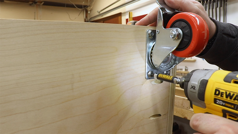 Attaching the casters to the bottom of the cabinet