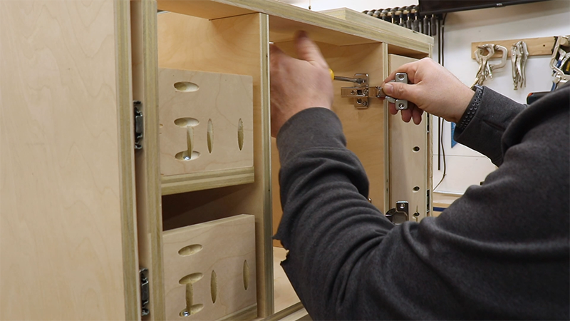Attaching the hinges to the cabinet