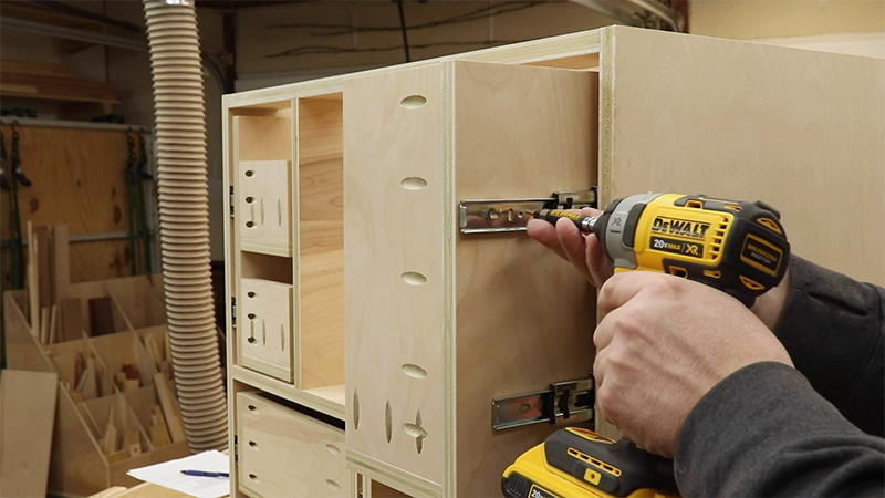 Attaching the pull out trays to the drawer slides