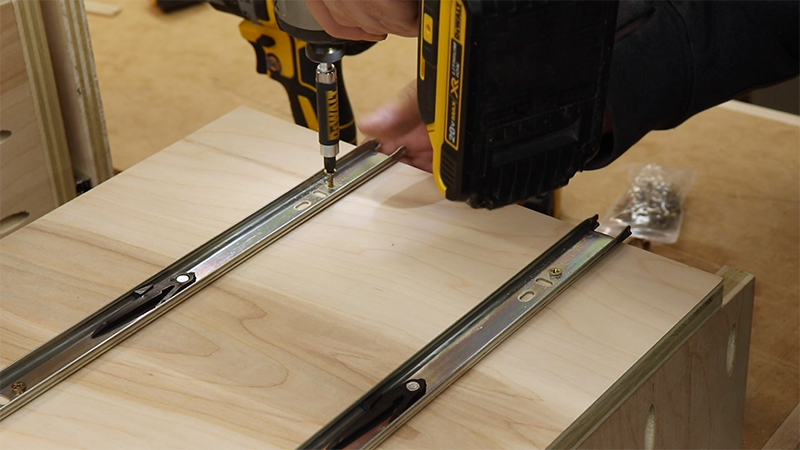 Fastening the drawer slide to the pull out tray