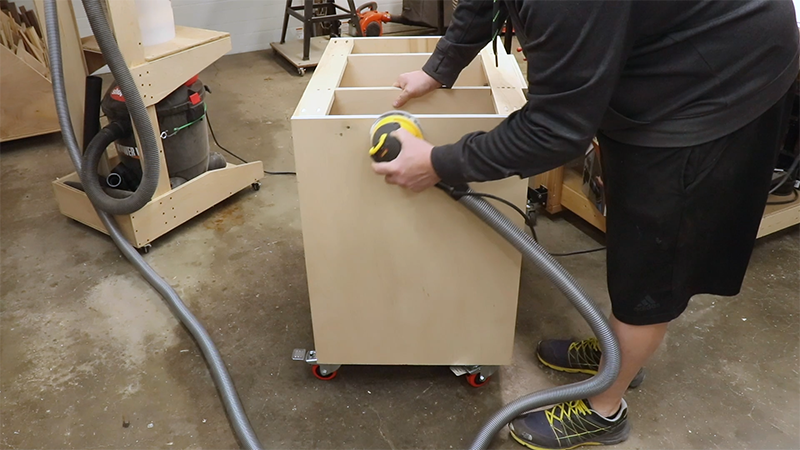 Sanding the sides of the cabinet