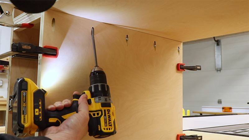 Using pocket screws to attach the vertical dividers